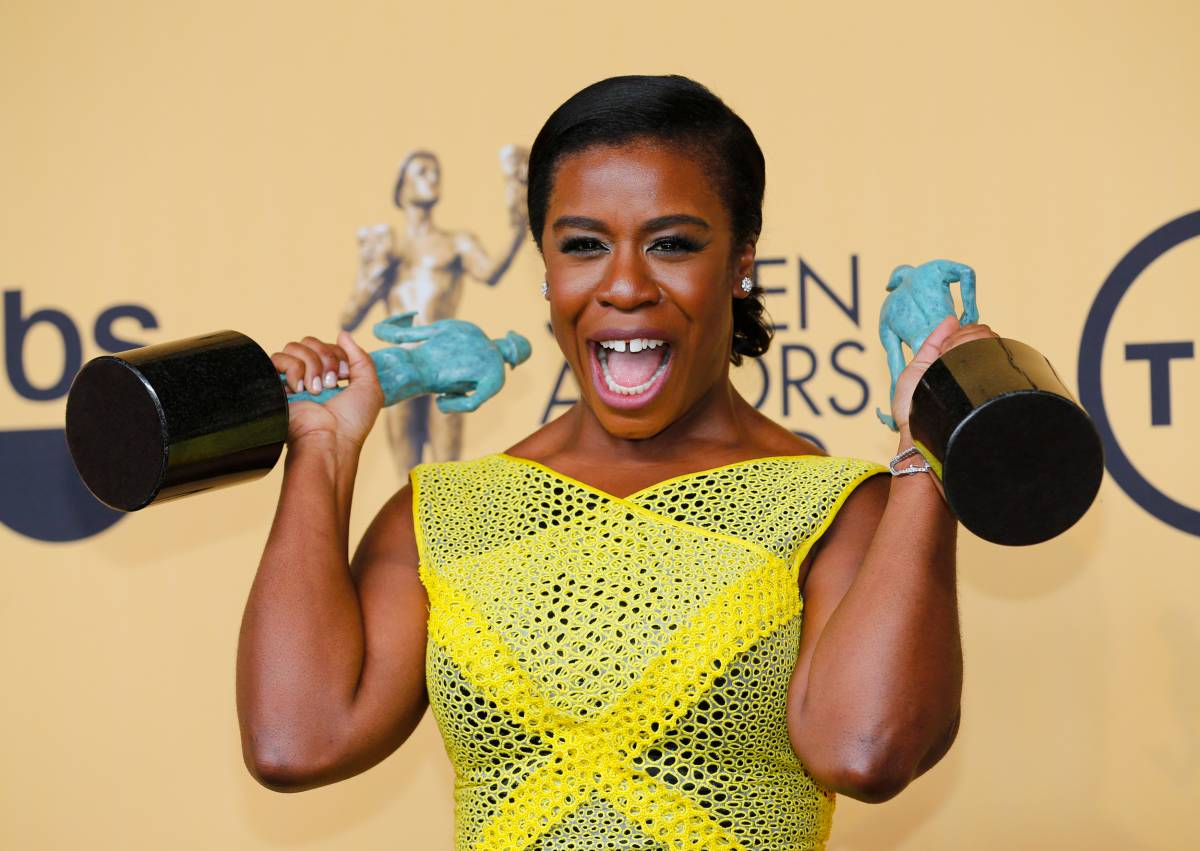 """Uzo Aduba of the Netflix series """"Orange is the New Black"""" poses backstage with her award for Outstanding Performance by an Ensemble in a Comedy Series at the 21st annual Screen Actors Guild Awards in Los Angeles"""