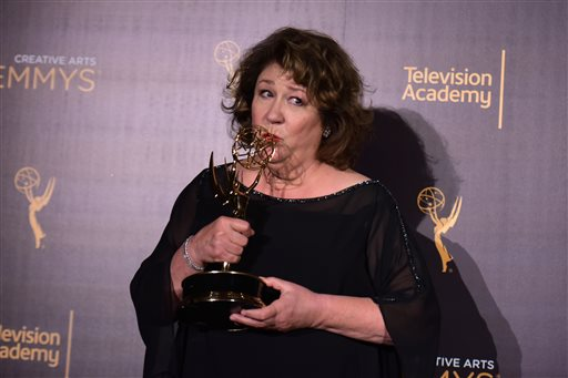 """Margo Martindale poses in the press room with the award for outstanding guest actress in a drama series for """"The Americans"""" during night one of the Creative Arts Emmy Awards at the Microsoft Theater on Saturday, Sept. 10, 2016, in Los Angeles. (Photo by Richard Shotwell/Invision/AP)"""
